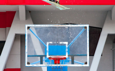 Ahmet Dadali gaps over a basketball hoop at the Podmežakla Sports Hall in Jesenice, Slovenia.