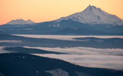 Sunset view of Mount Jefferson and the Three Sisters from Mount Hood, Oregon.